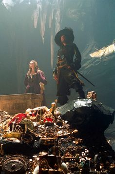 *ELIZABETH SWANN (Keira Knightley) + CAPTAIN HECTOR BARBOSSA (Goffrey Rush): PIRATES of the CARIBBEAN: The Curse of the Black Pearl (2003).