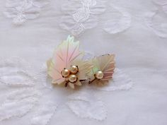 1940s Vintage Mother Of Pearl Leaf Brooch. Pearl, gold tone metal.  by Vintage0156 on Etsy https://www.etsy.com/listing/218534103/1940s-vintage-mother-of-pearl-leaf