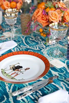 "Though the venue was outdoors, Ford and Fitzgibbons didn't sacrifice any comfort or style to the elements. Tables around a built-in banquette were set with a riotous ikat fabric, multicolor etched-crystal glasses, and linen napkins monogrammed in a vivid shade of purple. Rounding out the place settings were vintage Limoges plates, decorated with a pattern of exotic tribal scenes, which Ford picked up at Sotheby's. ""Using the same china and crystal you would use indoors makes the occasion…"