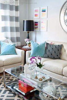 20 Ways to Decorate With Flowers For Spring - wide stripe curtains, sky blue and  graphic black and white pillows, + fuchsia flowers