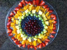 Rainbow fruit salad  Strawberries, mandarin, pineapple, green and purple grapes, blue berries.