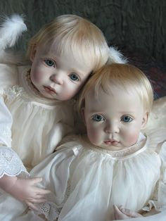 A repin of two porcelain baby dolls by artist Jeanne Gross