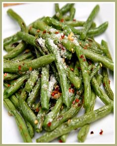 These fresh roasted green beans sprinkled with salt, fresh garlic, parmesan cheese and red pepper flakes  make for a great side dish to pair with meatloaf, steaks or roasted meats.