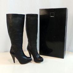Black Dolce Vita boots, size 7.5  Find more unique consignment pieces at www.revolverboutique.com