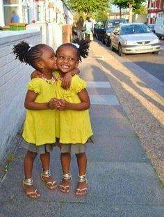 Natural hair twin girls. Cornrows leading up to ponytail of twistouts