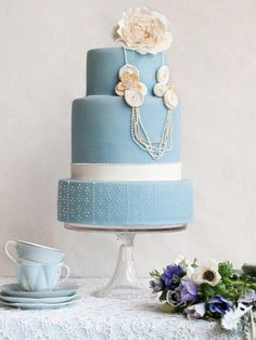 pink and blue wedding cake with pearls
