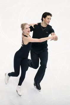 Ice dancers Kaitlyn Weaver (L) and Andrew Poje of Canada practice ahead of the Sochi 2014 Winter Olympics at the Iceberg Skating Palace on F...