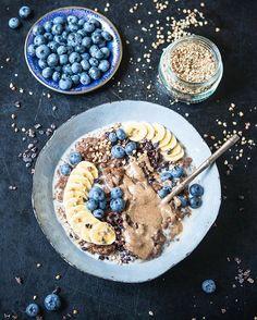 Cacao-Hazelnut-Teff Porridge w/ Blueberries, Cacao Nibs, Baby-Bananas, Buckinis & homemade roasted Hazelnut-Vanilla Butter!