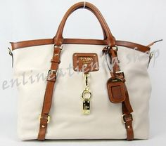 Well whaddaya know, found another one to drool after! Local supplier too!  Find this at  http://enlineatienda.multiply.com/products/listing/10098/PRE_ORDER_PRADA_MILLED_LEATHER_TOTE?x_source=mplist&x;_term=michael%20kors%20tote