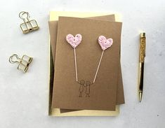 A simple design for an anniversary, Valentines, or simply to say 'I love you' - or perhaps for an engagement or wedding. Alternative design available here: http://etsy.me/2Et5HAm The card features 2 crochet hearts, handmade from cotton yarn. The yarn is tied together on the inside