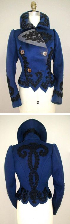 Deep Royal Blue Jacket, 1895 -1905, This double-breasted outer coat, c. 1900, is made of Melton wool that has been dyed deep royal blue. The outside of the coat is decorated with black cotton passementerie braid at the front lapels, around the collar edge, down center front, around the hem to the back. Center back has a large motif as well as do the lower edges of sleeve hems.