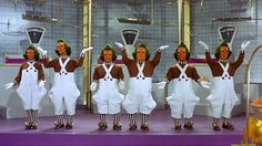 The mysterious Oompa Loompas are the Greek chorus of 'Willy Wonka,' moralizing about the loss of each unfortunate child through songs ('Oompa, loompa, doompity do...') and tumbling acts. Wonka's factory helpers, whom he says he brought back from faraway Loompaland, are portrayed in the book as having 'golden-brown hair' and 'rosy-white skin', but the orange faces and green hair of the movie are how we best remember them today. (1971 version)