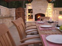 A limestone fireplace and large outdoor dining table make the terrace at HGTV Dream Home 2005 a prime gathering spot for guests.