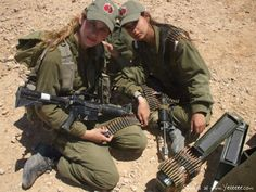 These women are gorgeous. Imagine them climbing through the mud holding guns.