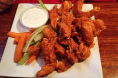 A plate of buffalo chicken tenders from R.F. O'Sullivan's, a restaurant and bar on Beacon Street in Somerville, MA. (from http://hiddenboston.com/foodphotos/osullivans-tenders.html)