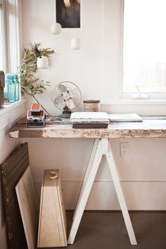 DIY Desks You Can Make In Less Than a Minute (Seriously!). Photographer and food blogger Erin Scott built this charming desk by placing century-old pockmarked planks of wood across vintage sawhorses, spray painted white. See other details from her home on Design Sponge.