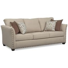 Luxuriously Comfortable. Make a grand statement with the Mckenna Queen memory foam sleeper sofa that exudes classic appeal. With its comfortable seating, this furniture features oversized nailhead trim adorning the ever-stylish flared arms. Complemented beautifully by patterned and contrasting colored accent pillows, the relaxing sand fabric is versatile and will match any décor.