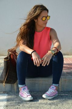 Complements are the essence of this 'street style' outfit on Spanish blogger Cristina García:neon coral sleeveless blouse + dark blue skinny jeans + pink Converse All Star low top sneakers + oversized brown & camel Louis Vuitton tote bag + mirrored sunnies + gold-tone on sunglasses' metallic details,ring,watch and spiked bangle bracelets.Casual with a certain sophisticated chic touch.