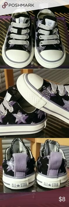 Converse Infant Girl Shoes Black with glittery light purple and dark purple stars all over!There's light staining on both of the shoes around the sides of the shoe where the first purple stripe touches the black fabric,the left shoe has a little scuff mark on the top of the shoe and a little stain on the inside.All are hardly noticeable but I tried to include pictures of them.Great for play, the glitter makes them extra fun and the flaws make them unique! Converse Shoes Baby & Walker