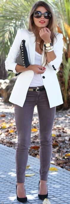 Another great looking and elegant outfit is seen in this image. Lady appears in a white tailored blazer worn atop simple white tee tucked in grey mid-rise skinnies. Personally, I like statement sunglasses, black leather clutch and those wrap bracelets teamed with watches.