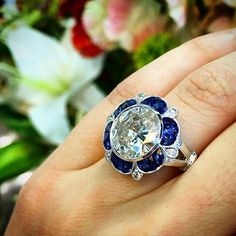 Diamond and sapphire engagement ring Found on -http://wonderpiel.com/