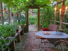 Amazing Greenhouse / Garden Room with lantern lights, candle chandelier, table for two, potted plants, bricks down below & vines up above . Backyard Greenhouse, Greenhouse Plans, Greenhouse Wedding, Greenhouse Film, Outdoor Rooms, Outdoor Living, Outdoor Decor, Orangerie Extension, White Clematis