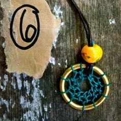 A step by step tutorial for weaving a dreamcatcher necklace.