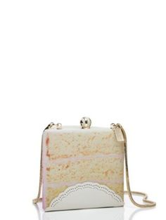 shaped like a slice of birthday cake, this purse will give any outfit a celebratory feel.