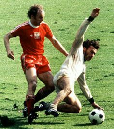 West Germany 1 Poland 0 in 1974 in Frankfurt. Paul Breitner makes a good tackle on Grzegorz Lato in Round 2, Group B at the World Cup Finals.