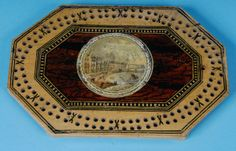 A whitewood Tunbridge Ware cribbage board with painted decoration and an applied print of Brighton Chain Pier. (England c. 1830) Offered by Amherst Antiques at The Edenbridge Galleries, Kent. www.edenbridgegalleries.com