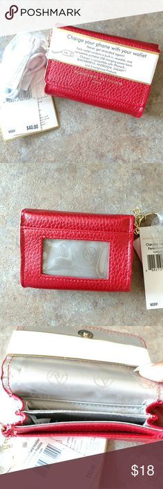 🎀 Adrienne Vittadini Phone Charging Card Holder Must have Adrienne Vittadini Phone Charging Card Holder/Keychain. Compatible with iPhone, Android, Blackberry, Galaxy, and Smartphone Products. Instructions attached. Adrienne Vittadini Bags Wallets