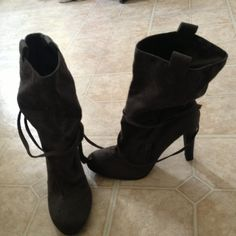 Grey high-heeled boots Slouchy, ties ; suede-like ; fits a bit small ; never worn ! Charlotte Russe Shoes Heeled Boots