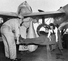 "A ""patient"" being prepared for transport during a drill 1944. The aircraft is an F-5B Lightning fitted with two drop tanks modified for use in high speed med evacuation operations."