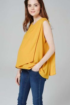 Keep stylish during your pregnancy with this Maternity drape blouse. Featuring a practical cross over panel at the front with hidden nursing function. Designed to wear through pregnancy and beyond. #topshop