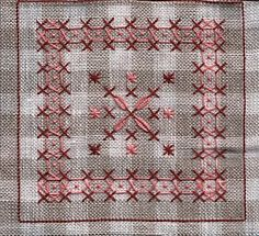 Biscornu façon broderie suisse 2 shades of reds, light pink and very deep pink, on linen color gingham.