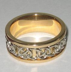 It''s 9mm wide and heavy, in 18k white and yellow gold. The white gold is all hand carved, and the polishing is wonderful.    Posted by Gale