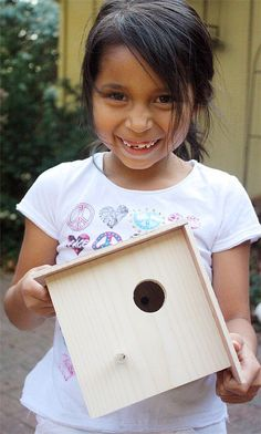 Look at how proud she is of her birdhouse! Very nice tutorial :)