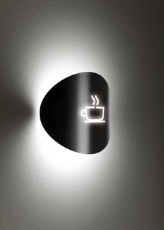 Outdoor wall sconce providing direct and indirect light. Acrylic shade with a curved metal decorative front plate. Suitable for outdoor locations. Hotel Signage, Wayfinding Signage, Signage Design, Name Plate Design, Coffee Shop Signs, Cafe Sign, Sign Board Design, Lobby Design, Outdoor Wall Sconce