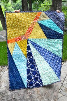 Sunshine quilt http://www.ocd-obsessivecraftingdisorder.blogspot.ca/2013/07/a-quilt-for-ryker.html?m=1