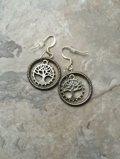 A personal favorite from my Etsy shop https://www.etsy.com/listing/467503297/silver-hoop-tree-of-life-earrings
