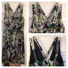 Green, Black, and Purple Pattern Dress Fun jungle pattern dress with purple, green, and Black. Has two sets of straps, one crosses like an X in the back, and the other falls on the shoulders. V-neck. Very comfortable! Jennifer Lopez Dresses