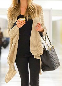 Tan sweater with black outfit.