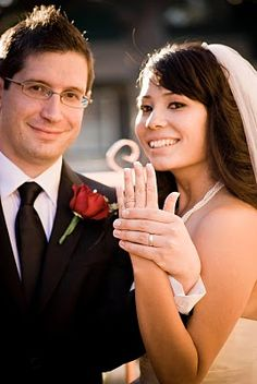 The Glasses take a second to steal away from their backyard wedding to take some portraits.