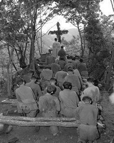 Chaplain Kenny Lynch conducts services north of Hwachon, Korea, for men of 31st Regt. August 28, 1951. Pvt. Jack D. Johnson. (Army)