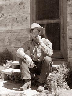 Cowboy by Bunkhouse. Quarter Circle U Ranch, Montana. 1939