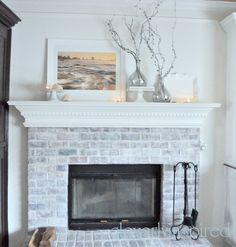 Winter-white mantel.  I hope to gather white linens, fill glass bottles with white lights, and various, uh, WHITE accessories, just for the rest of the winter.  Then I'll switch to spring.