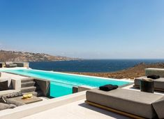 Villa Genesis at Mykonos is available for rent, and located in the prime area of Aleomandra, facing the deep blue waters of the Aegean sea. Villa Genesis is impeccably designed to combine modern style with traditional Mykonian architecture Luxury Villas In Greece, Mykonos Town, Hotel Services, Pool Maintenance, Beautiful Villas, Jacuzzi, Night Life, Terrace, Balcony