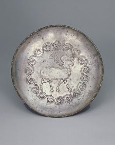 Plate with Trees and Ibex in Center  600-700      Sasanian period    Silver gilt; hammered, chased, and gilded  Iran