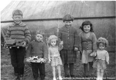 The O'Mahony children of Monatrea, Waterford, Ireland, on Christmas The girls showing off their Irish Crolly Dolls, made in Donegal. Vintage Photographs, Vintage Photos, Black White Photos, Black And White, Girls Showing Off, Effigy, Doll Parts, Donegal, Favorite Holiday