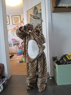 Rory's tiger costume is finally fully finished. Tiger Costume, Monkey, Sewing, House, Cheetah Costume, Monkeys, Dressmaking, Tigger Costume, Couture